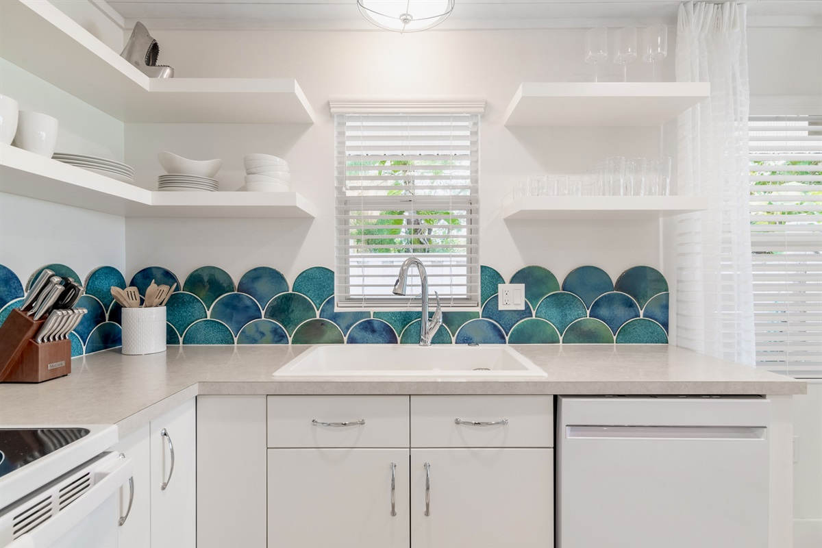Watercolored handmade, hand glazed clay tiles are the focal point of the kitchen.