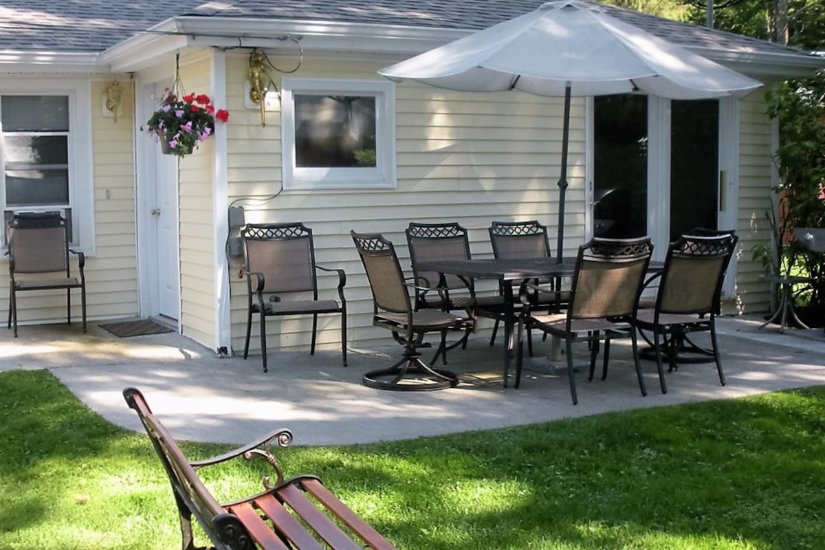 Patio for outdoor dining and conversation with gas grill and fire pit for campfires and s'mores