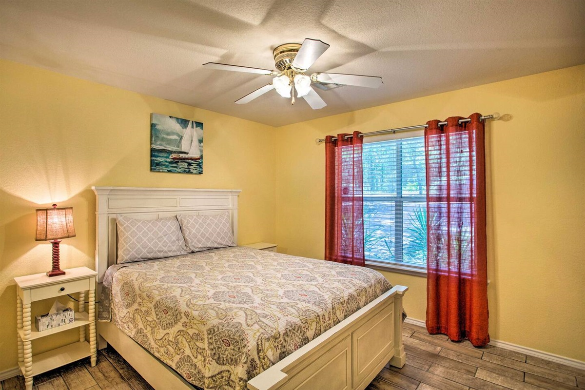 Yellow bedroom with queen size bed
