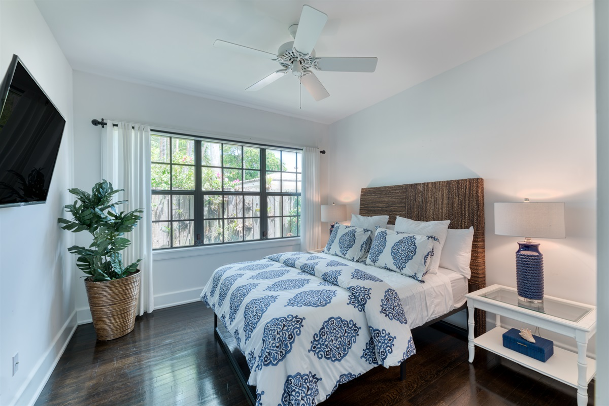 The 3rd Bedroom has a gorgeous rustic charm with woven headboard with Queen bed and gorgeous ceramic blue side lamps. Great closet space and large windows bring in warm sunshine. Smart TV!