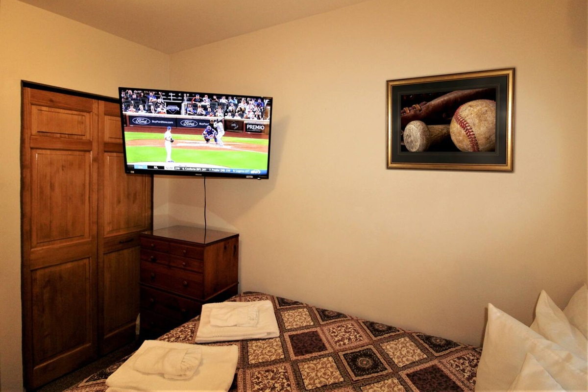 "Bedroom #1 with 43"" (or larger) flat screen smart Roku TV to watch all your favorite teams or shows from the comfort of your air-conditioned bedroom"