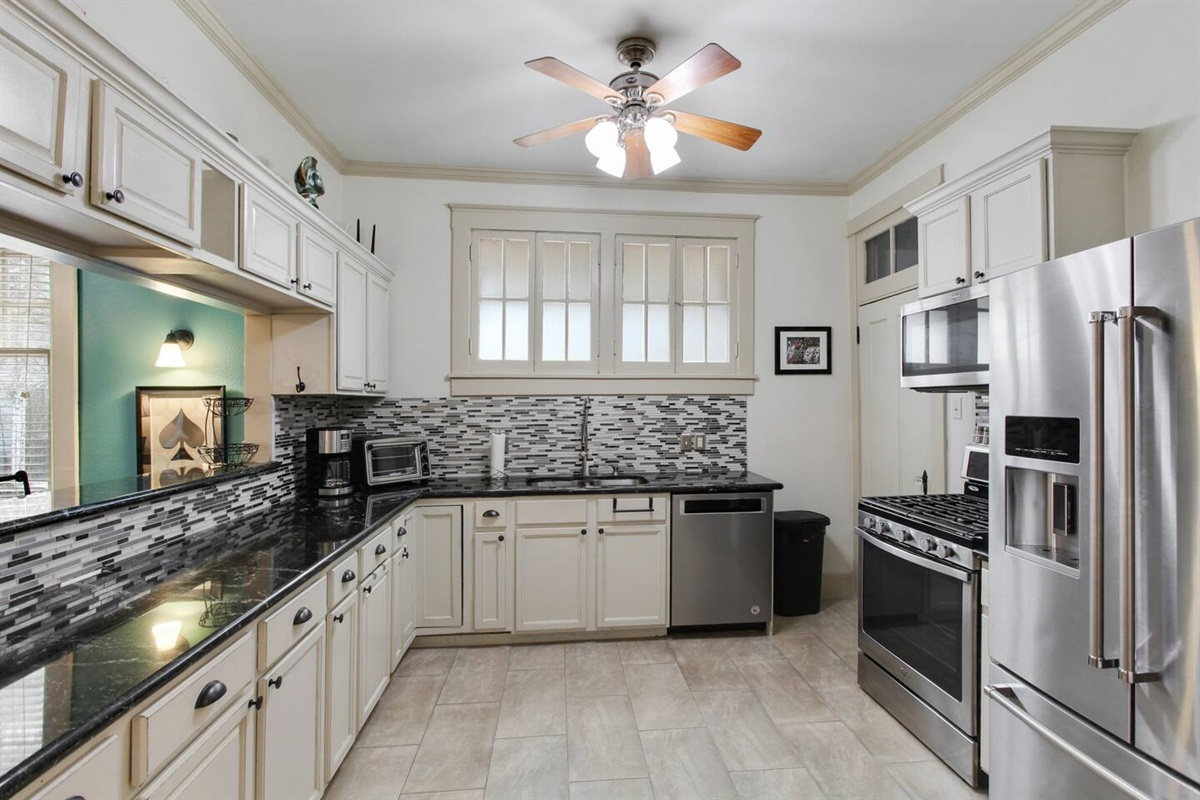 Spacious fully equipped kitchen. New Kitchaid and GE appliances. Gas range. Filtered water/ice. Quiet dishwasher. Super fast microwave. Disposal. Toaster. 12 cup coffee.