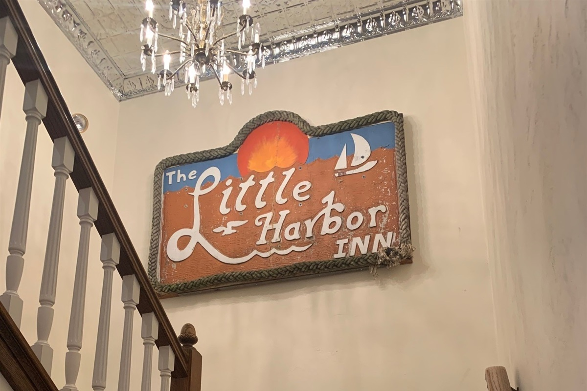 We kept the original Little Harbor Inn sign and hung it on the main staircase!