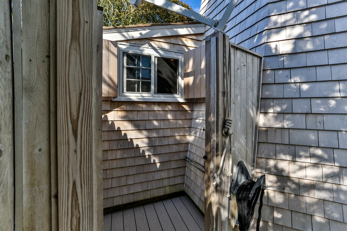 Roomy and private outdoor cedar shower is located around the side of the windmill off of the front patio.