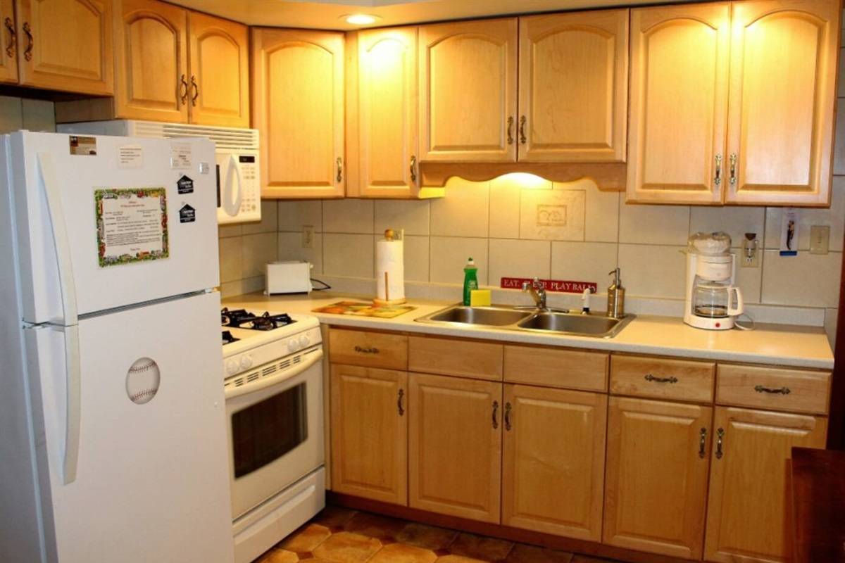 Spacious kitchen with gas stove, refrigerator with automatic ice maker and over the range microwave