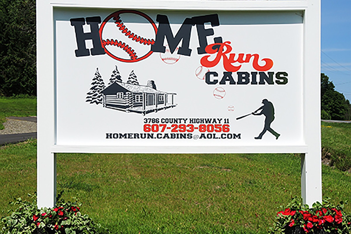 Home Run Cabins entry sign