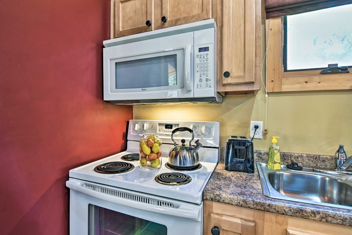 The kitchen is fully equipped with up-to-date appliances.