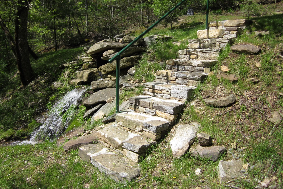 Beautiful rock stairs leading down to the creek