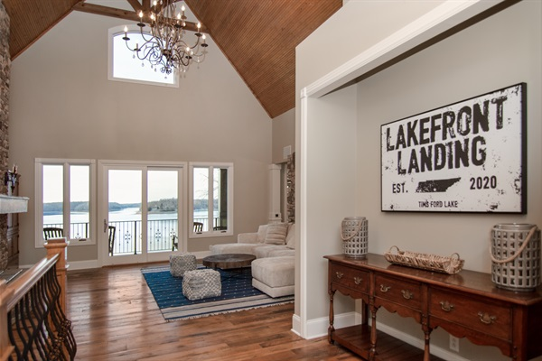 Majestic lakefront views and high custom ceilings welcome you to Lakefront Landing