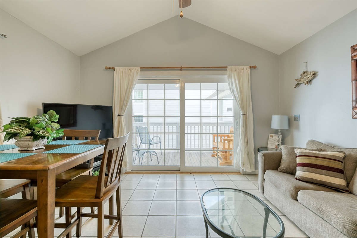 Large sliding glass doors lead to the porch