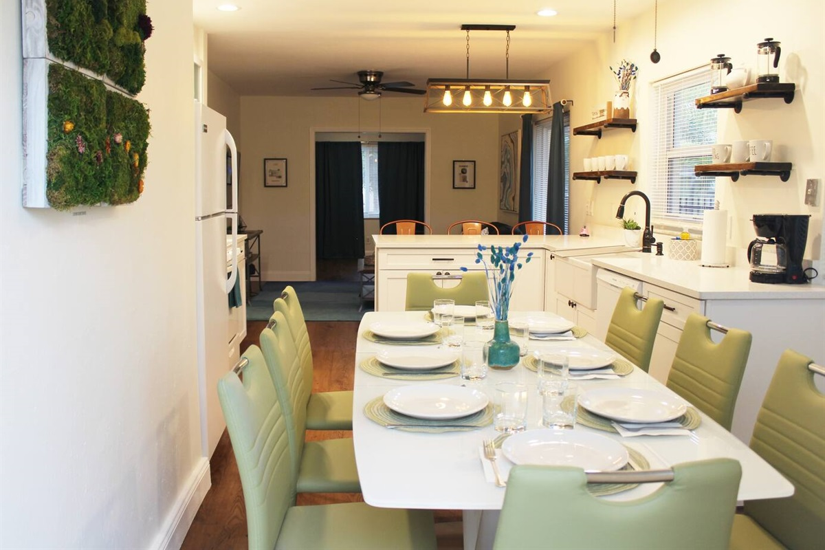 For groups of 8 looking to host a formal dinner, the drop leaf table can be temporarily extended to accommodate all 8 chairs. The table setting used is from apartment decorations inside.