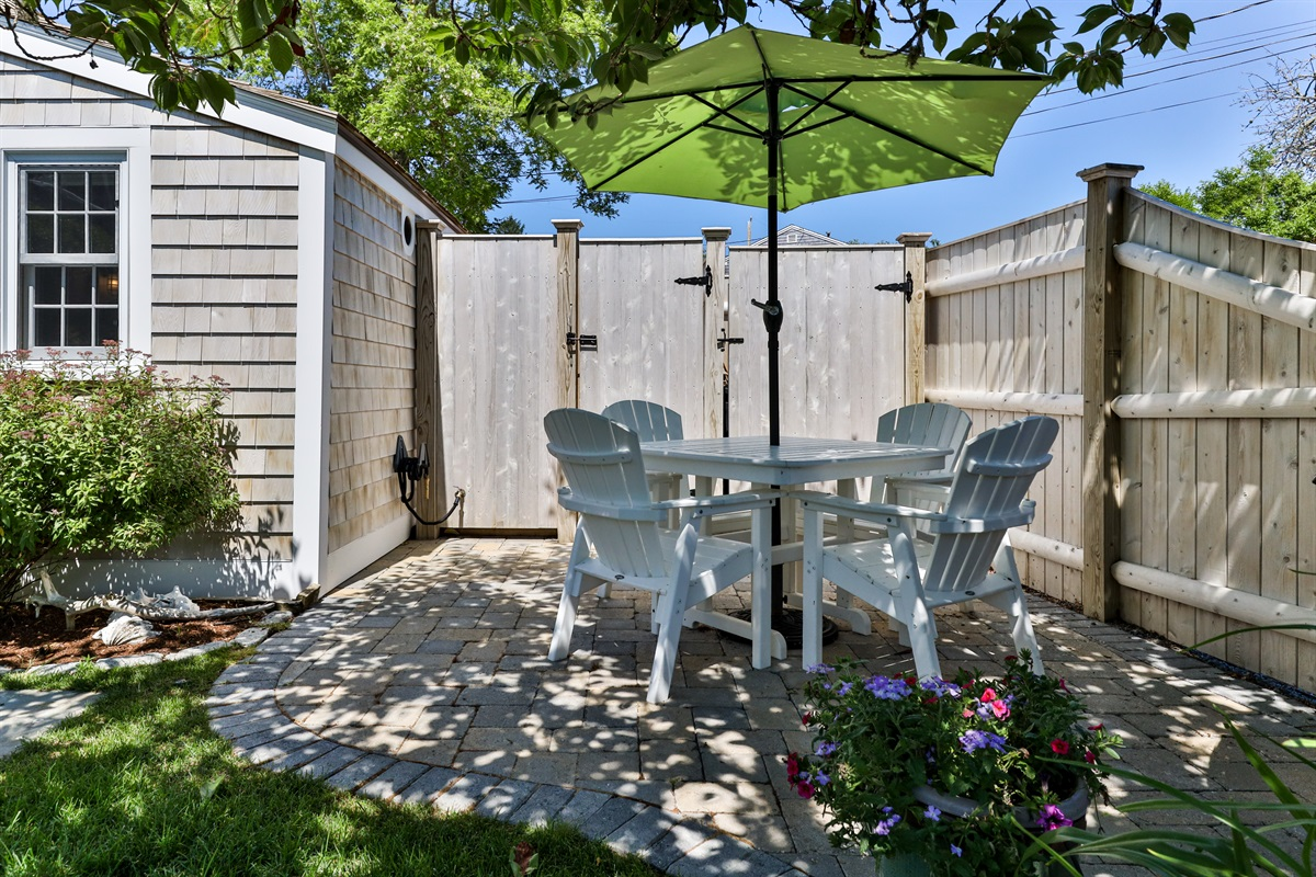 A bluestone walkway leads to the patio which is adjacent to The Artist Cottage. The private outdoor shower is located to the rear of the patio. The yard is impeccably maintained with flowering annuals and perennials throughout the summer season.