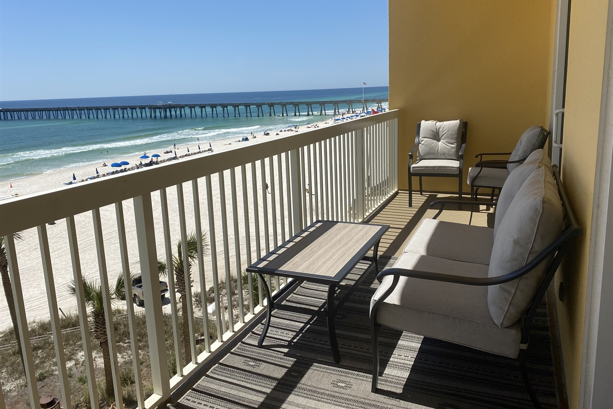 Balcony has comfortable seating for six