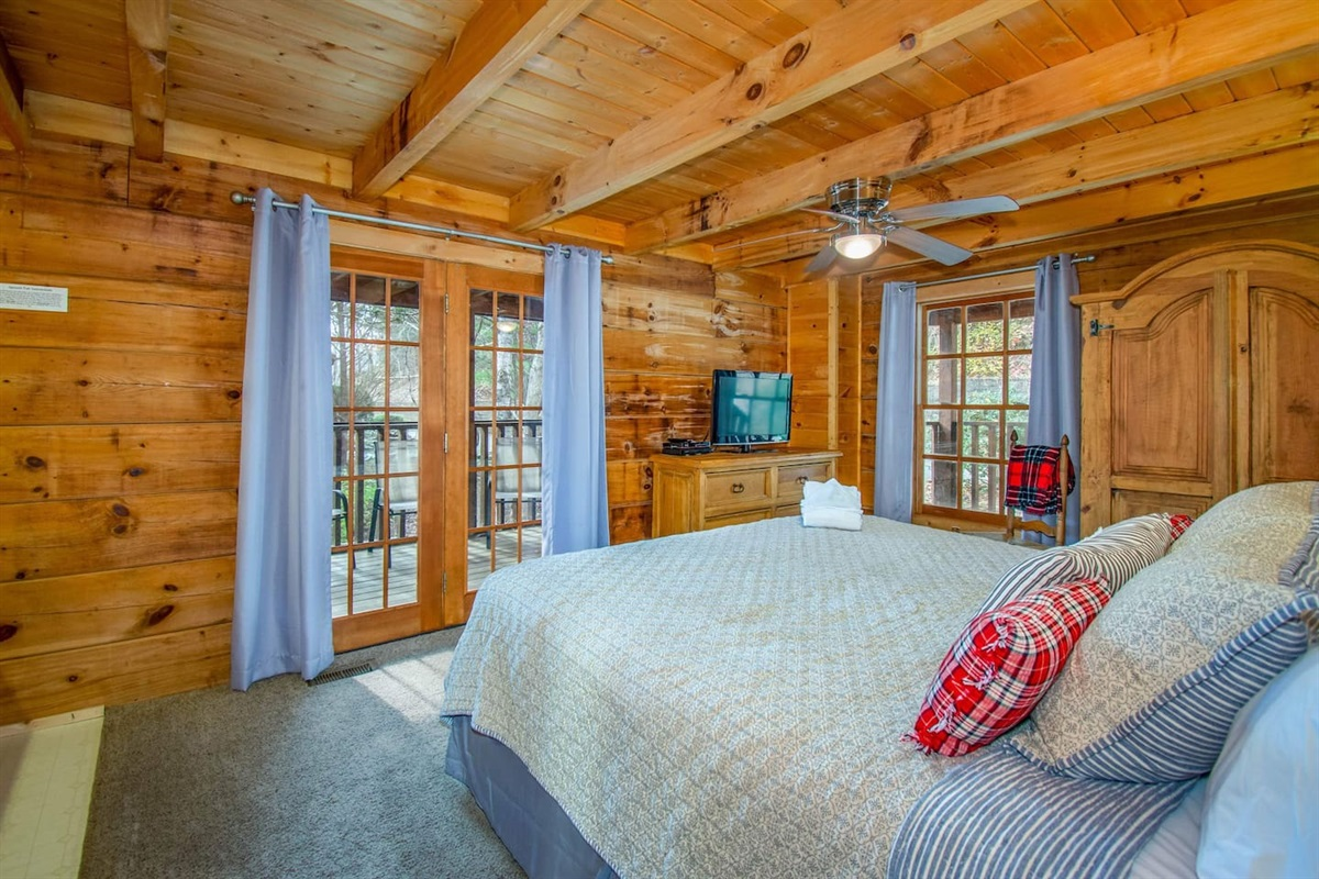 Main level bedroom with King bed and deck access.