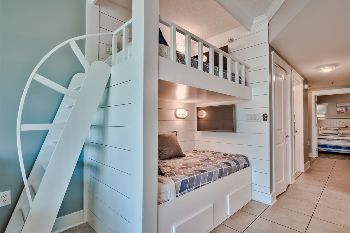 Designer bunk beds with their own TV's featuring Netflix