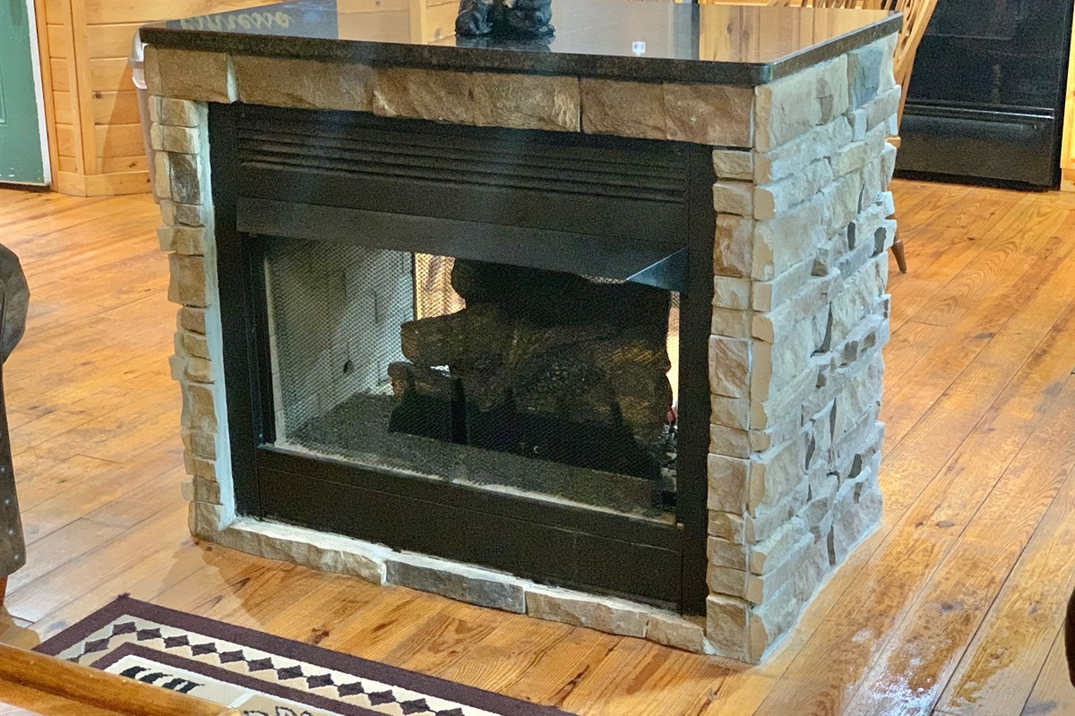 Two-sided Gas Fireplace opens up to Main Living Are and Kitchen/Dining Area
