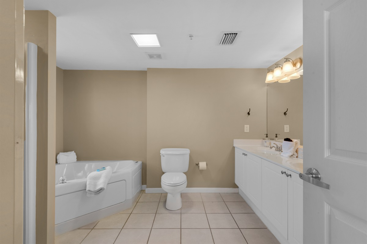 Master bathroom with walk-in shower, jacuzzi tub and double sinks