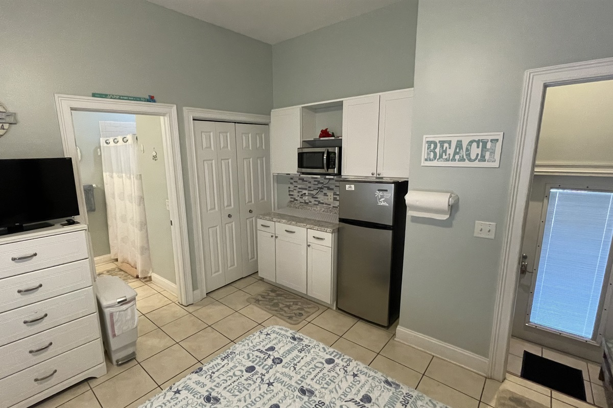 Refrigerator/microwave in ground level bedroom
