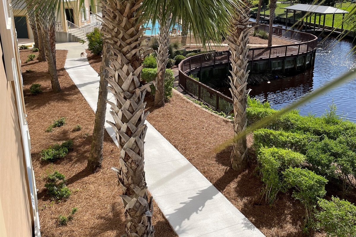 Two Sisters in Paradise is located in Waterside Village walkway to our beautiful pool