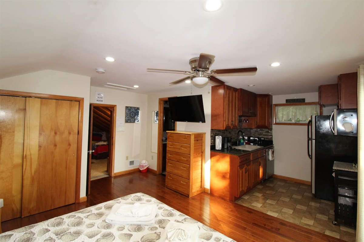 Upstairs queen suite with full size microwave, refrigerator, sink, coffeemaker and toaster to create your early morning snack!