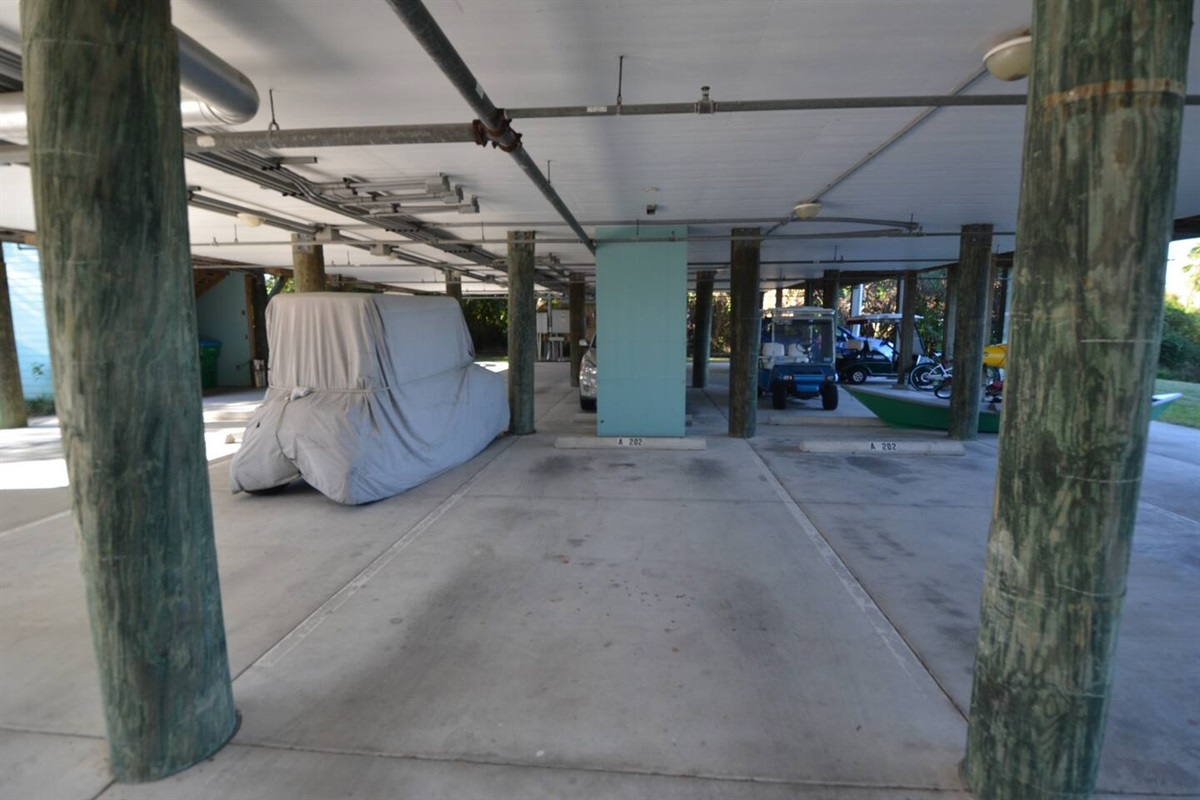 Covered reserved parking space for unit for your vehicle or a rented golf cart
