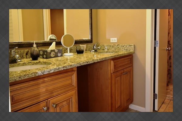 Master Bathroom With New Stone Counter Top, Faucets and Vanity.