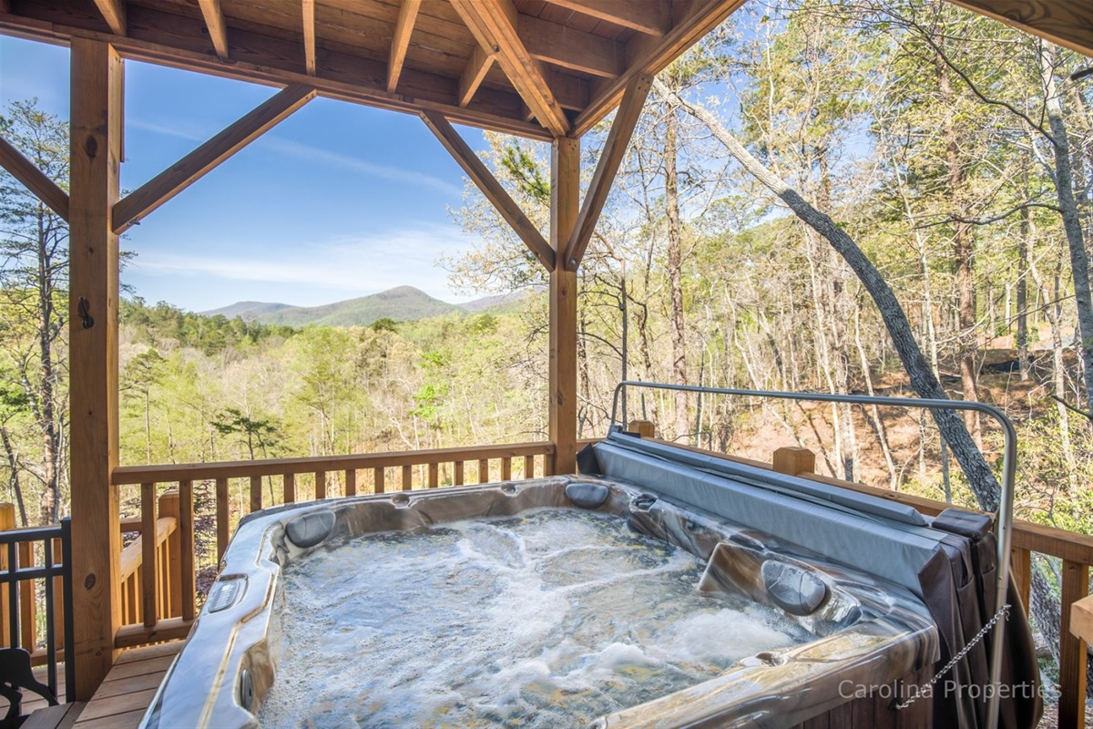 Hot tub on lower level deck overlooking the mountains