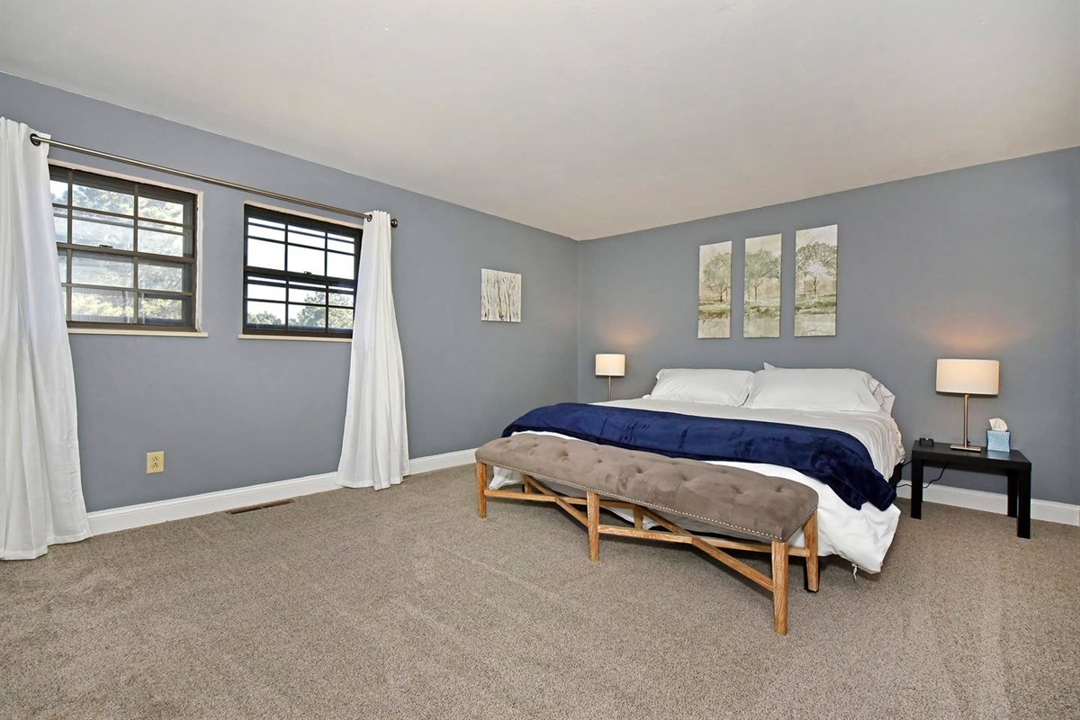Get a great night's sleep in this king bed in the master bedroom. Charging blocks on the nightstands are there for easy charging of all your electronics!