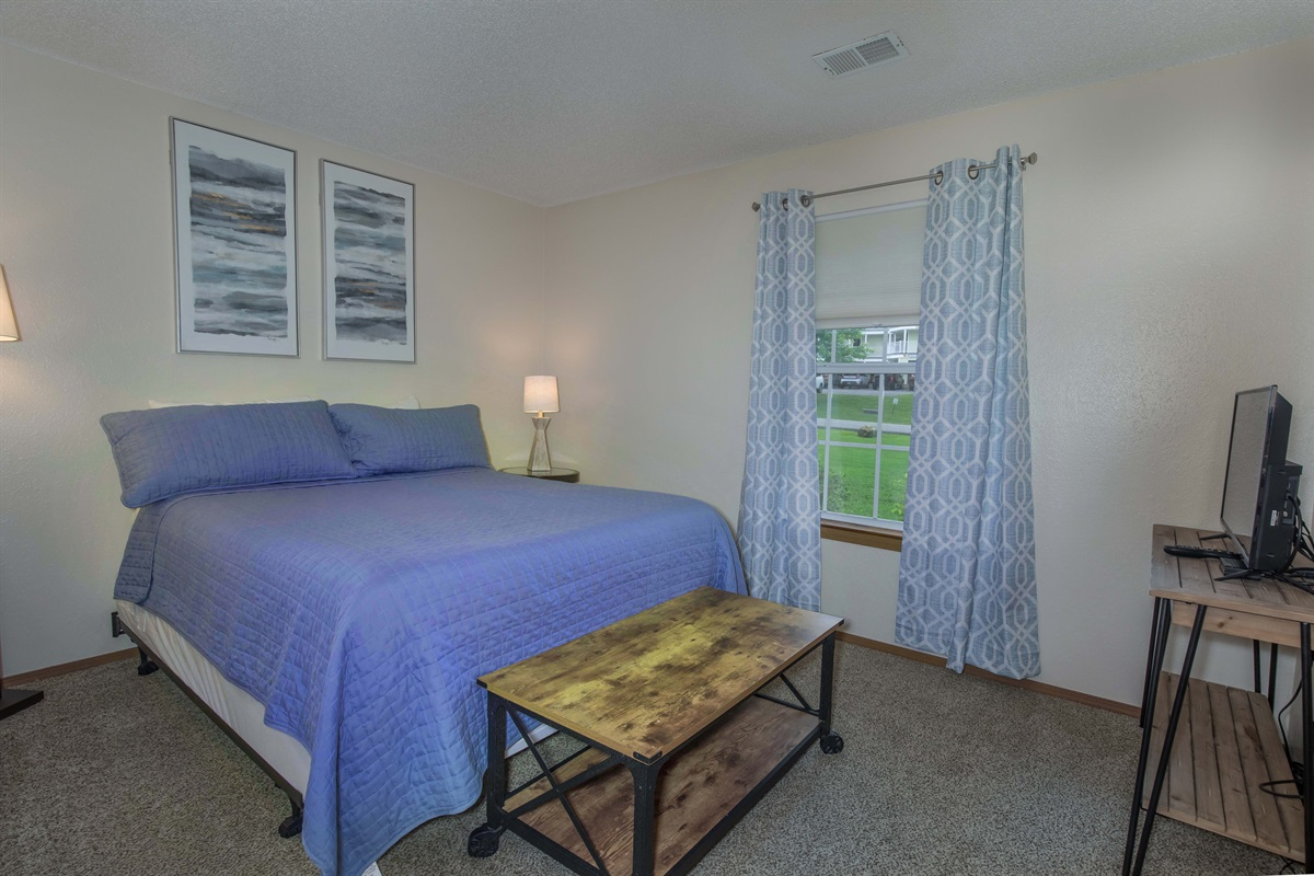 A brand-new queen bed awaits in the guest bedroom!