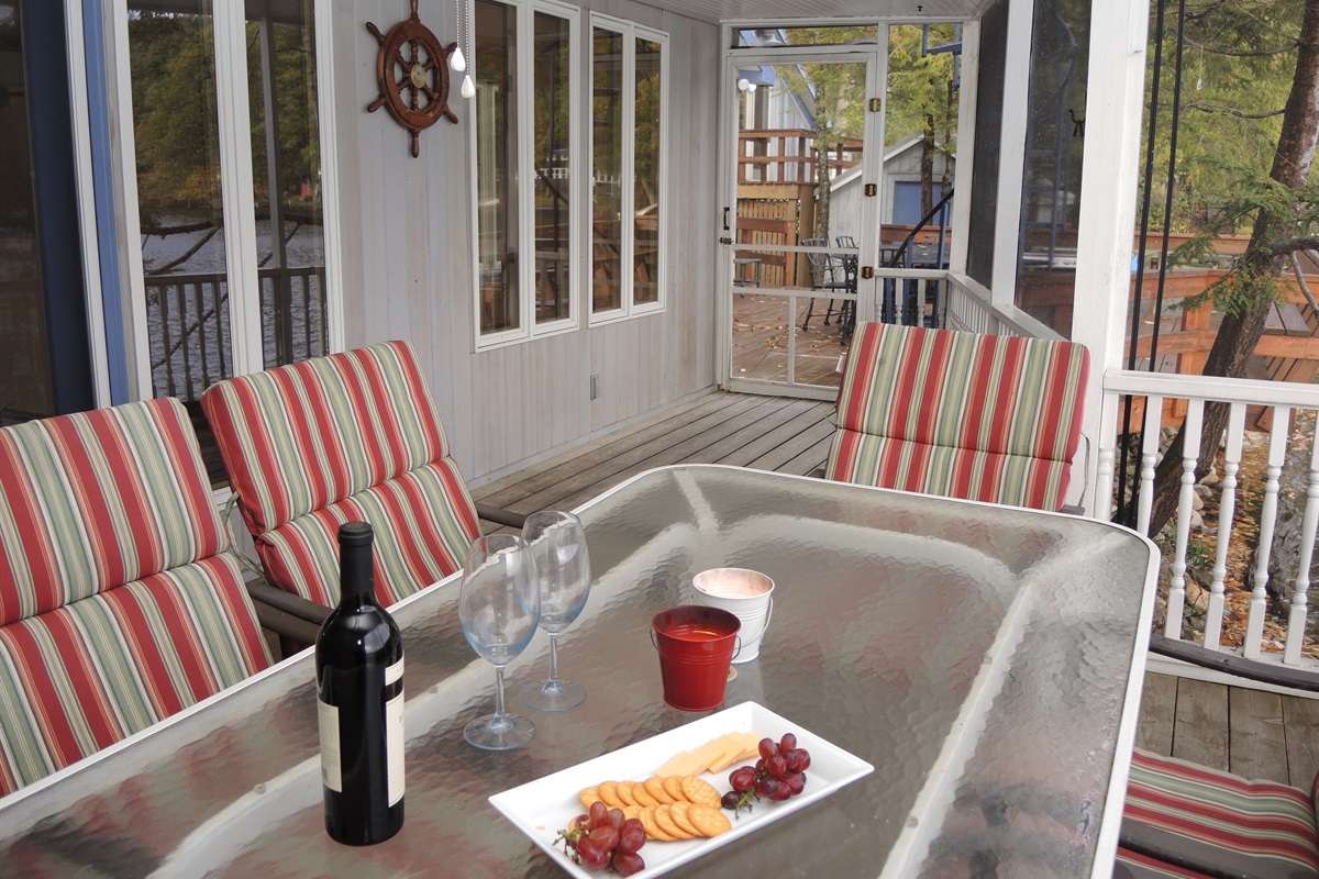 Sweet Spot Lakehouse - Screened in porch with lake view. Access to  outside.