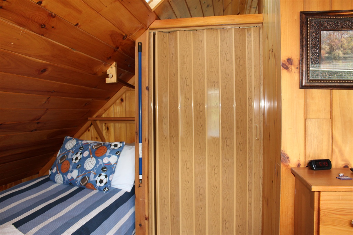 """King bedroom and twin bedroom are """"railroad"""" style.  You will pass through the king bedroom to get to the twin room.  They are separated by a folding door"""