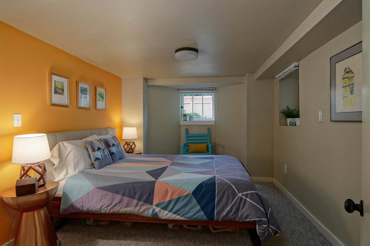Bedroom #2 is slightly smaller, and located at the end of the hall, and front of the house.