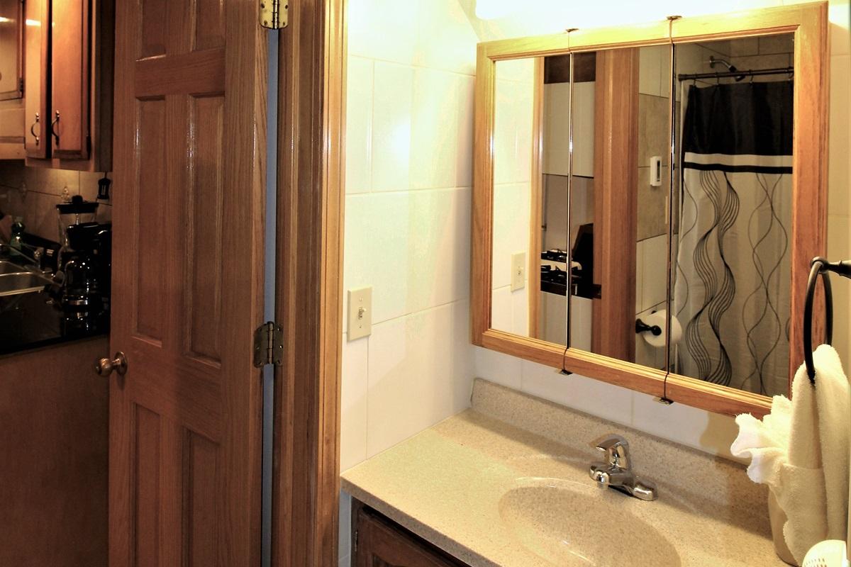 Modern, fully tiled bathroom