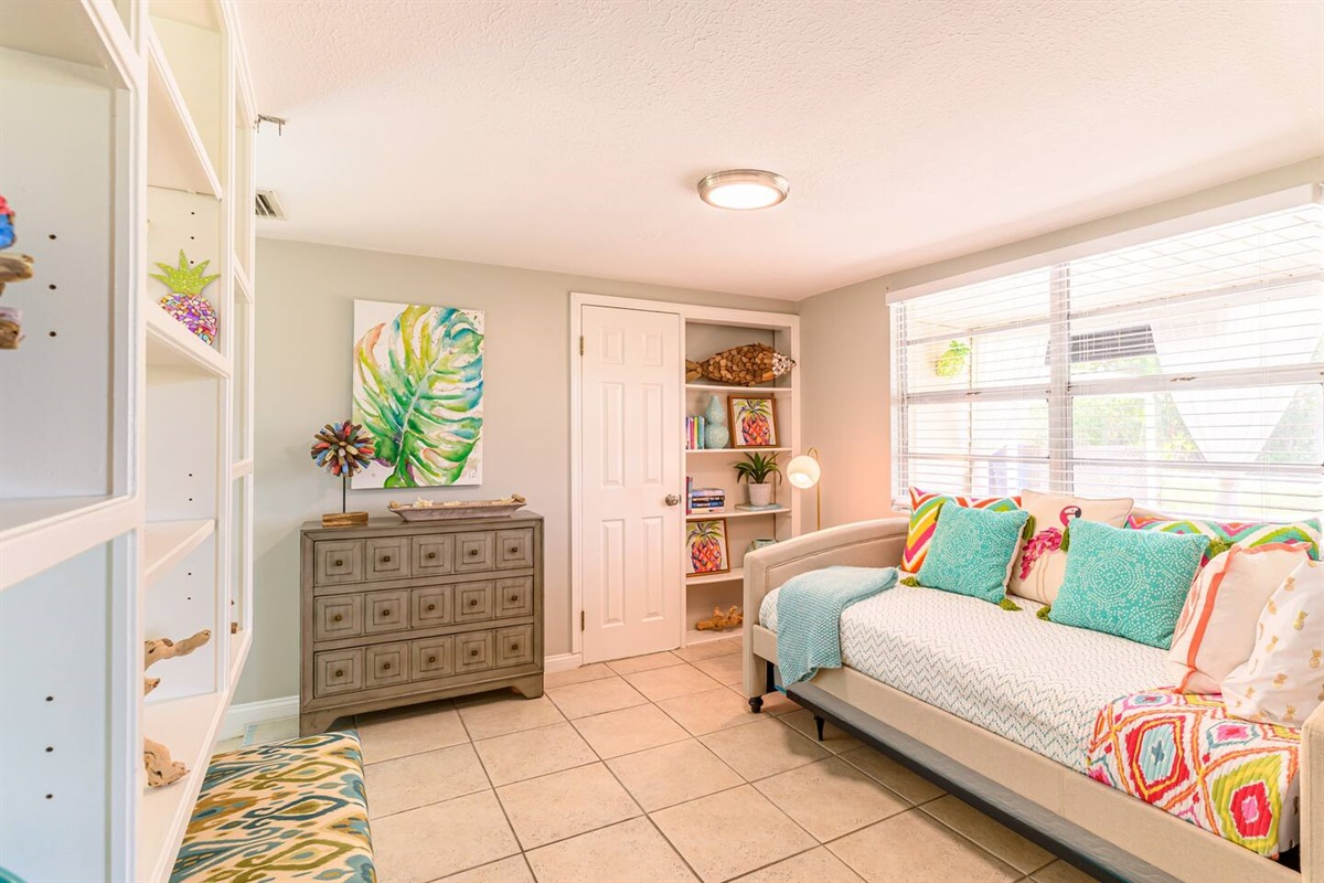 This room is open to the living room and dining room.  It is perfect for kids.  The pull out bed (under the daybed) has a weight limit of 75lbs.