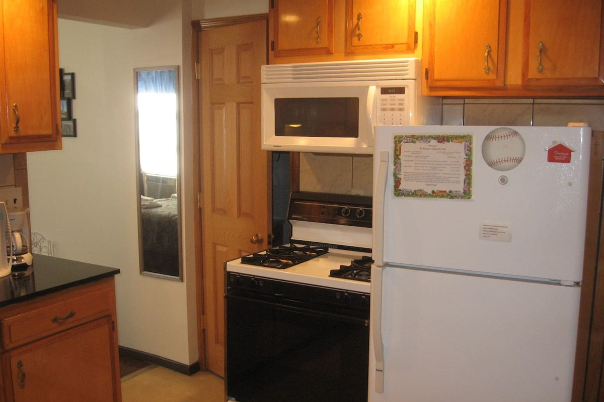 Gas range with over-the-range microwave.  Automatic ice maker in the full size refrigerator.