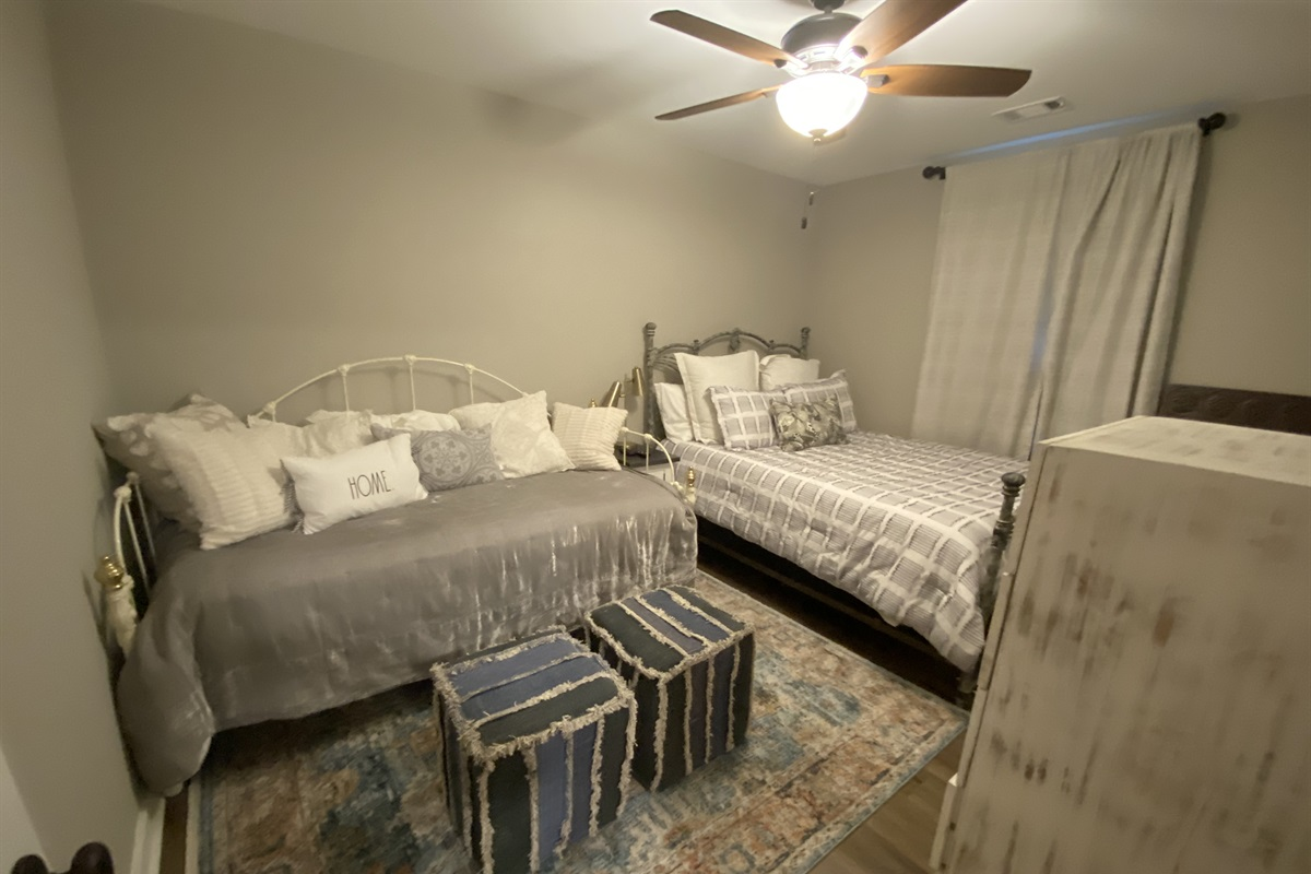Guest Bedroom featuring Queen bed an a Twin with Trundle. Room is equipped with a Smart TV.