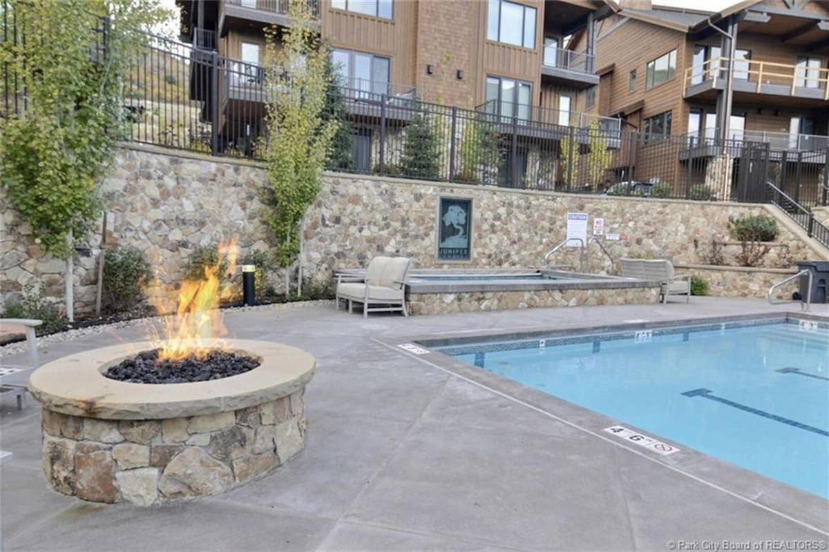 25 yard heated outdoor salt water pool with heated patio, hot tub, fire pit and fitness center which includes a sauna and changing rooms