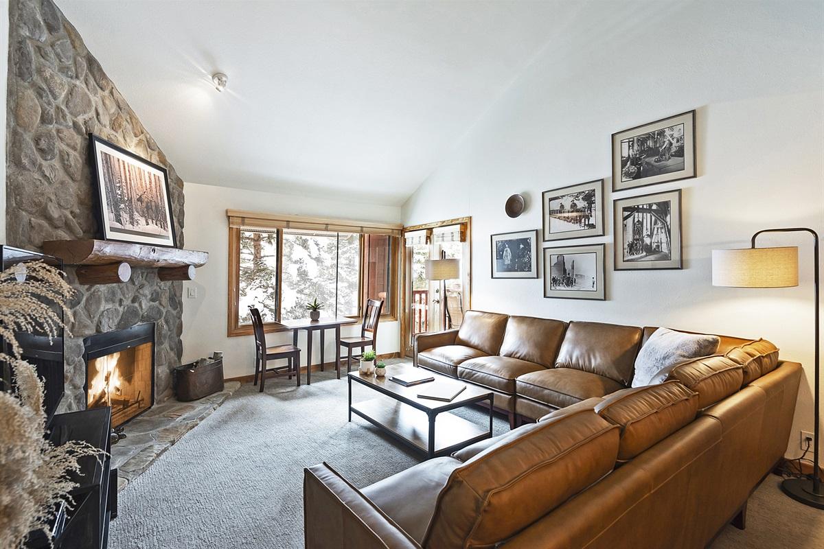 Living area, gas fireplace, flatscreen TV, doors to deck