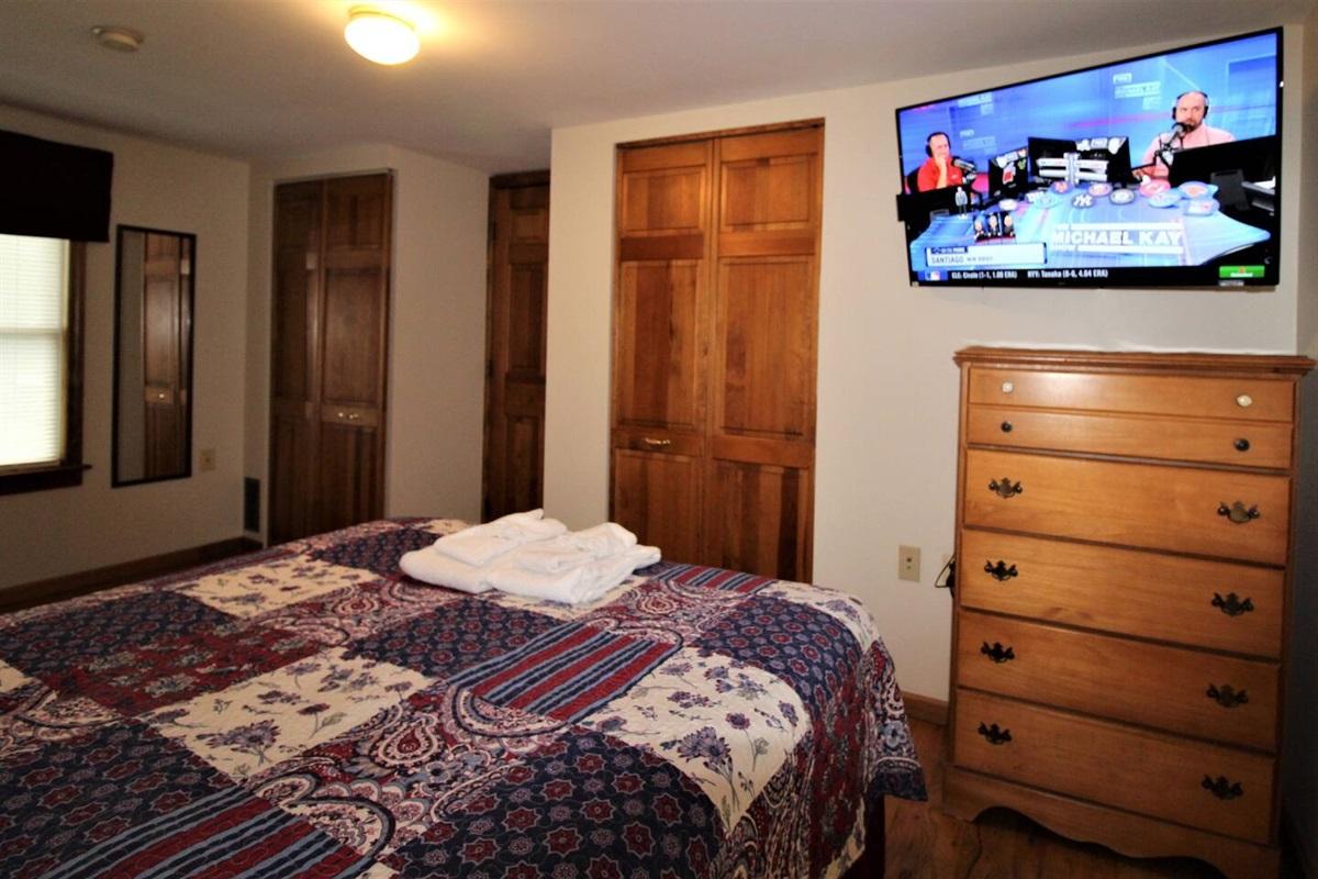 Bedroom #3 with queen bed, flat screen smart Roku TV.