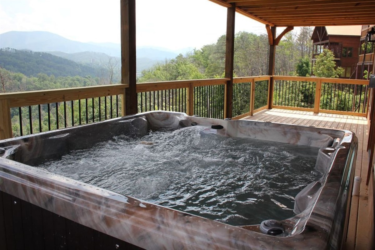 Relax in the hot tub with waterfall and enjoy the view of Mt LeConte