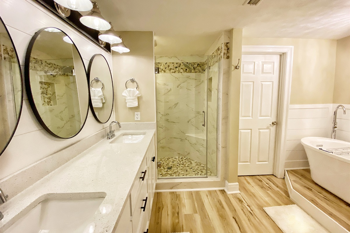 New tile shower, shaker doors, stand alone tub and quartz counters