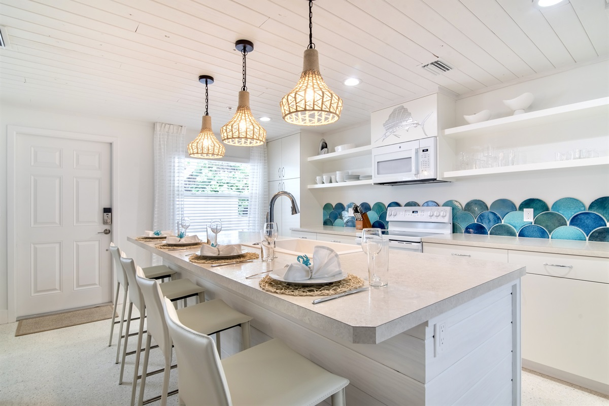 Fresh, bright open floor plan with new tongue and groove ceilings with kitchen skylight.