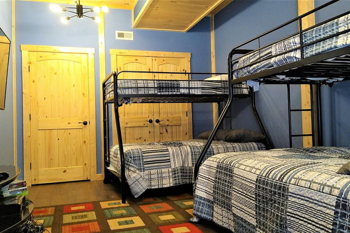 Bunk Room. Twins on top, Full (doubles) on bottom.  TV has an Xbox 360.