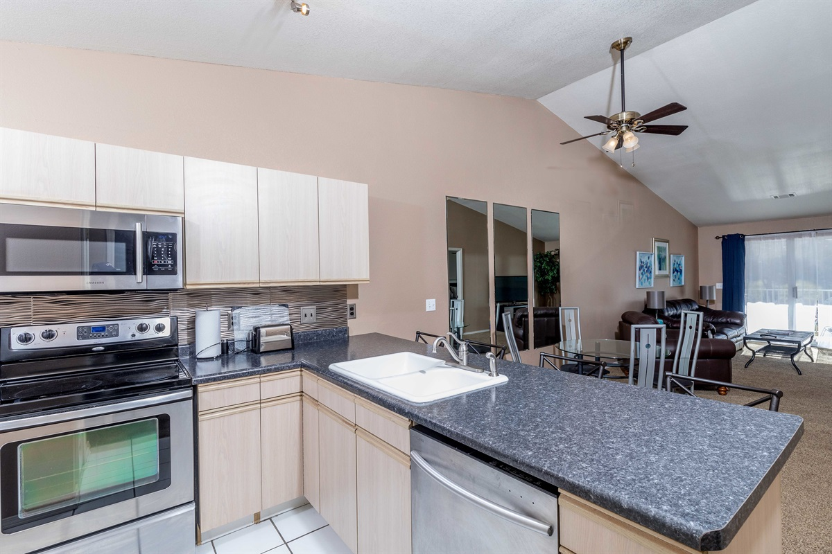 Plenty of counter space in the kitchen makes preparing home-cooked meals easy!