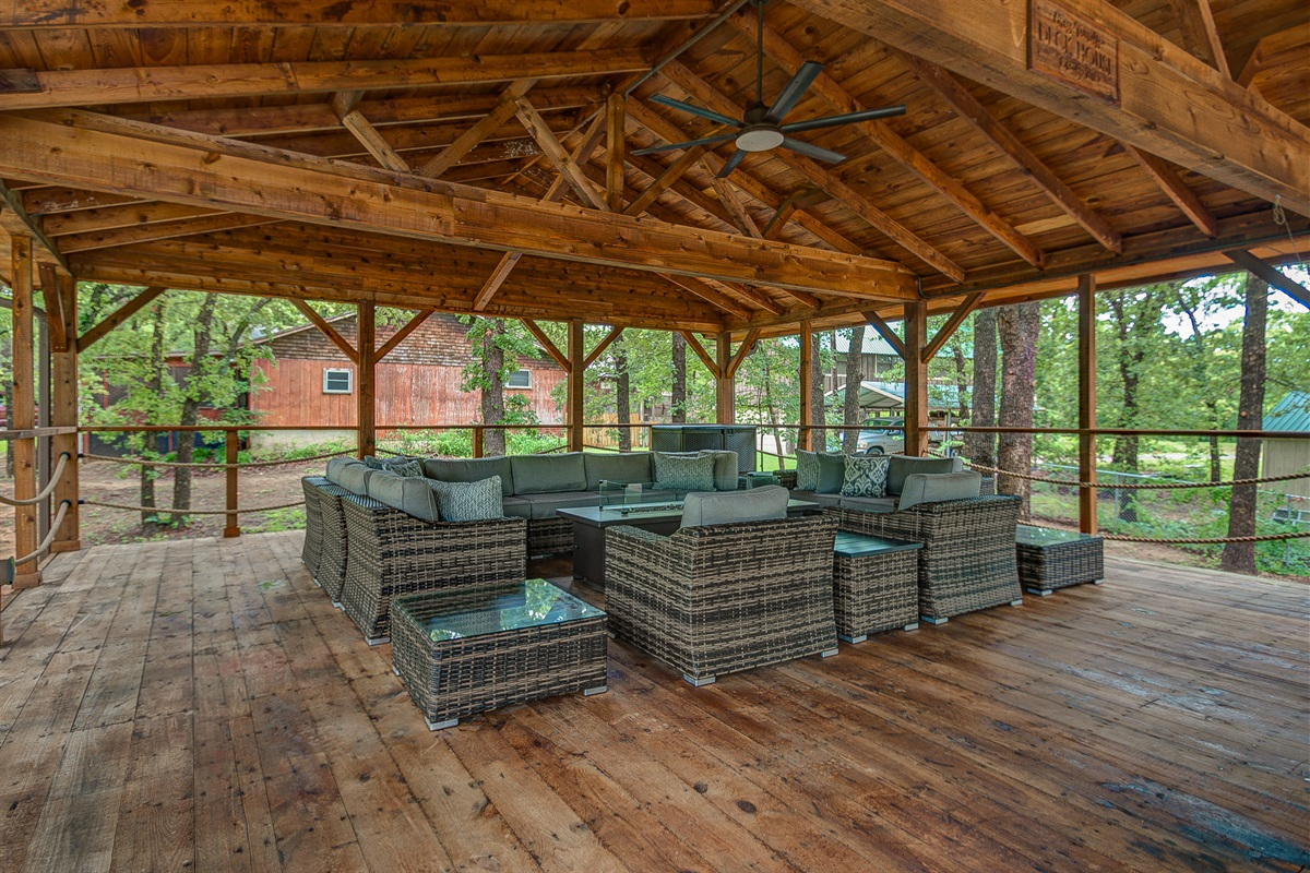 Couches surround outdoor gas fireplace