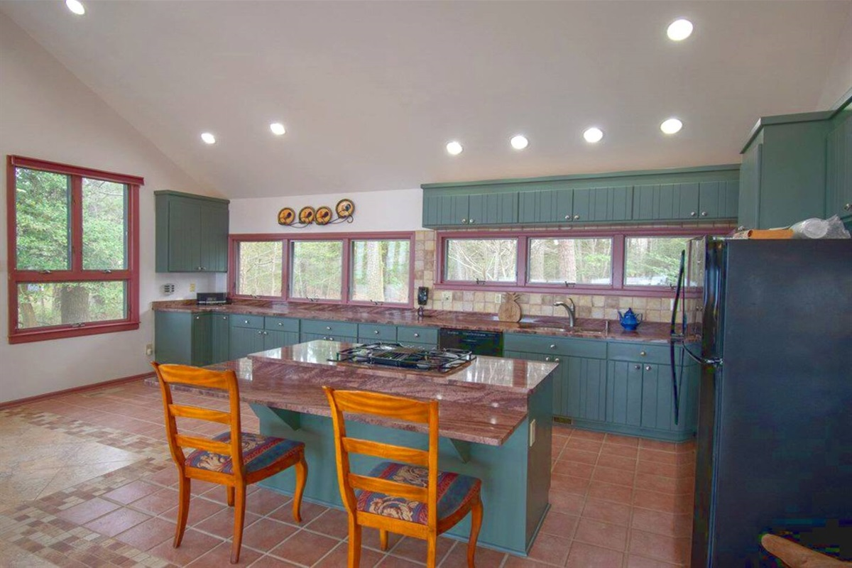 Kitchen with granite countertops, gas cooktop, additional eating area