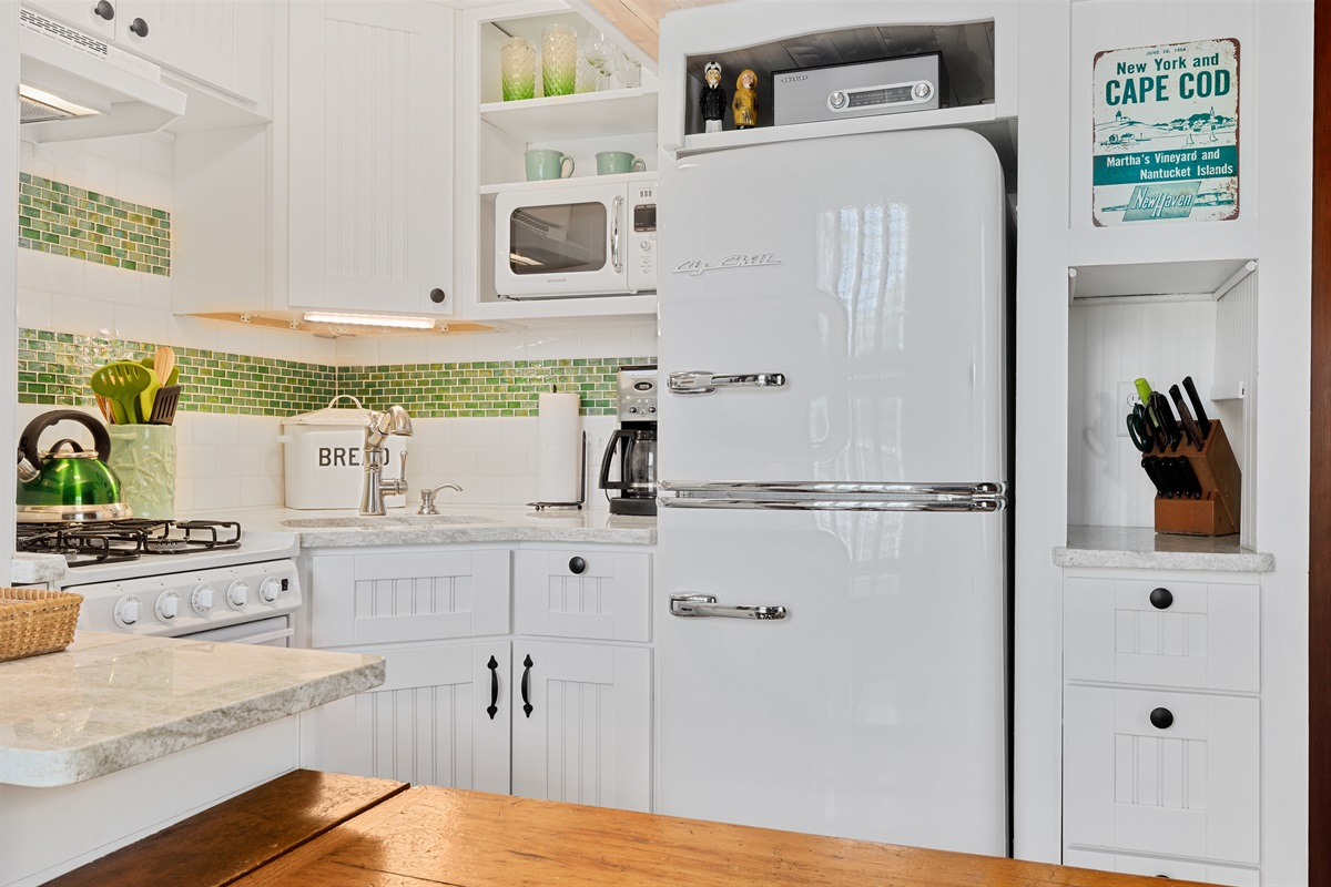 Recently renovated galley style kitchenette with new vintage designed appliances provide for a retro living and cooking experience. Keurig and traditional drip coffee makers are available for your use.