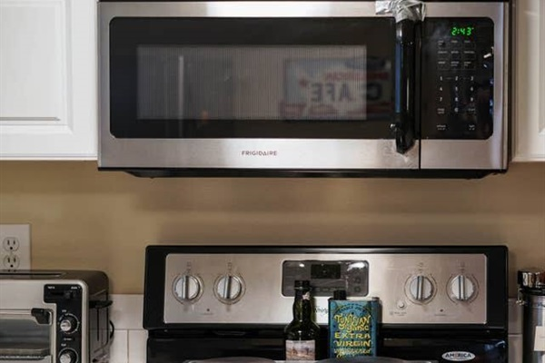 """The """"stove"""" is really a two burner hot plate, plus a microwave. If we are home, guests are welcome to bake pizza, etc, in our oven upstairs."""