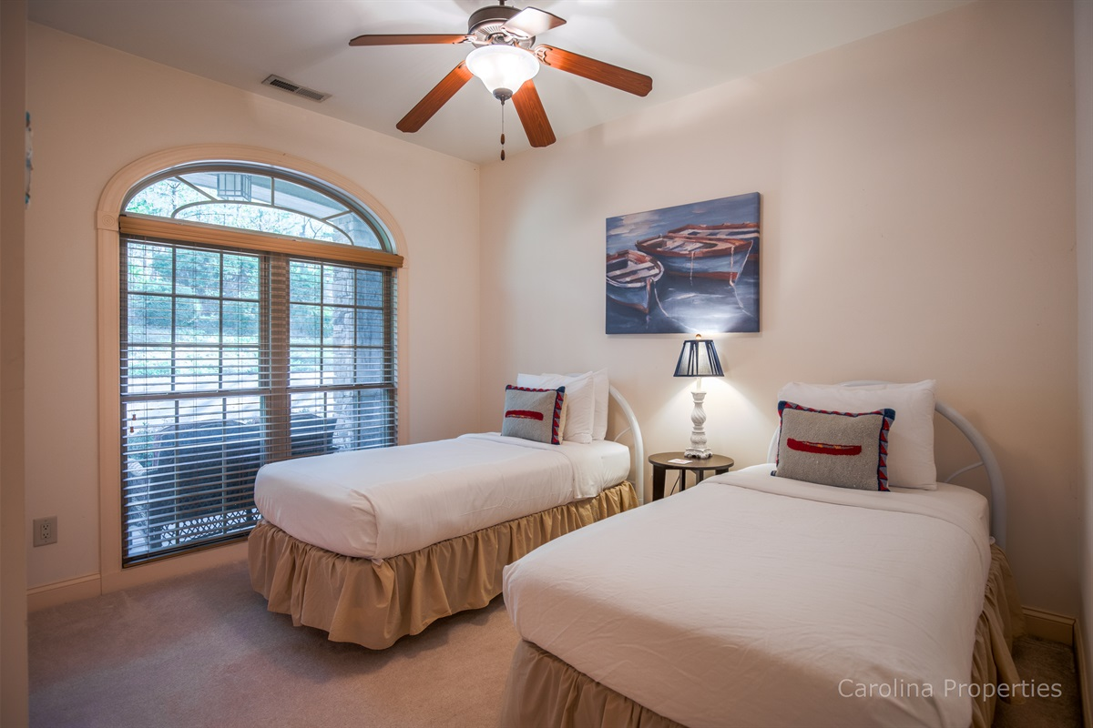 Main level bedroom 3 with two twin beds