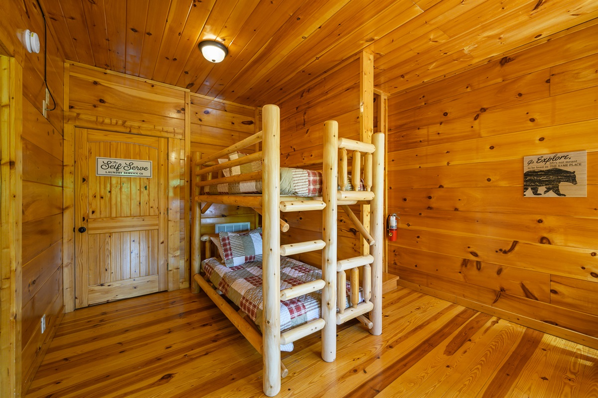 Twin over twin bunk beds located in the lower queen bedroom.